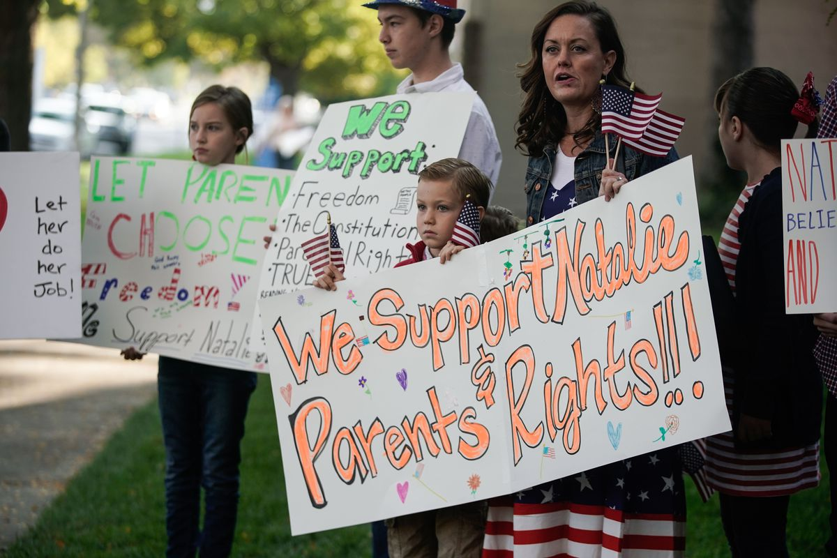 People take part a rally in support of Utah Board of Education member Natalie Cline in Salt Lake City on Thursday, Oct. 7, 2021.