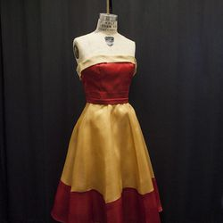 Another member of the Capulet tribe wears this bold, yellow and red frock.
