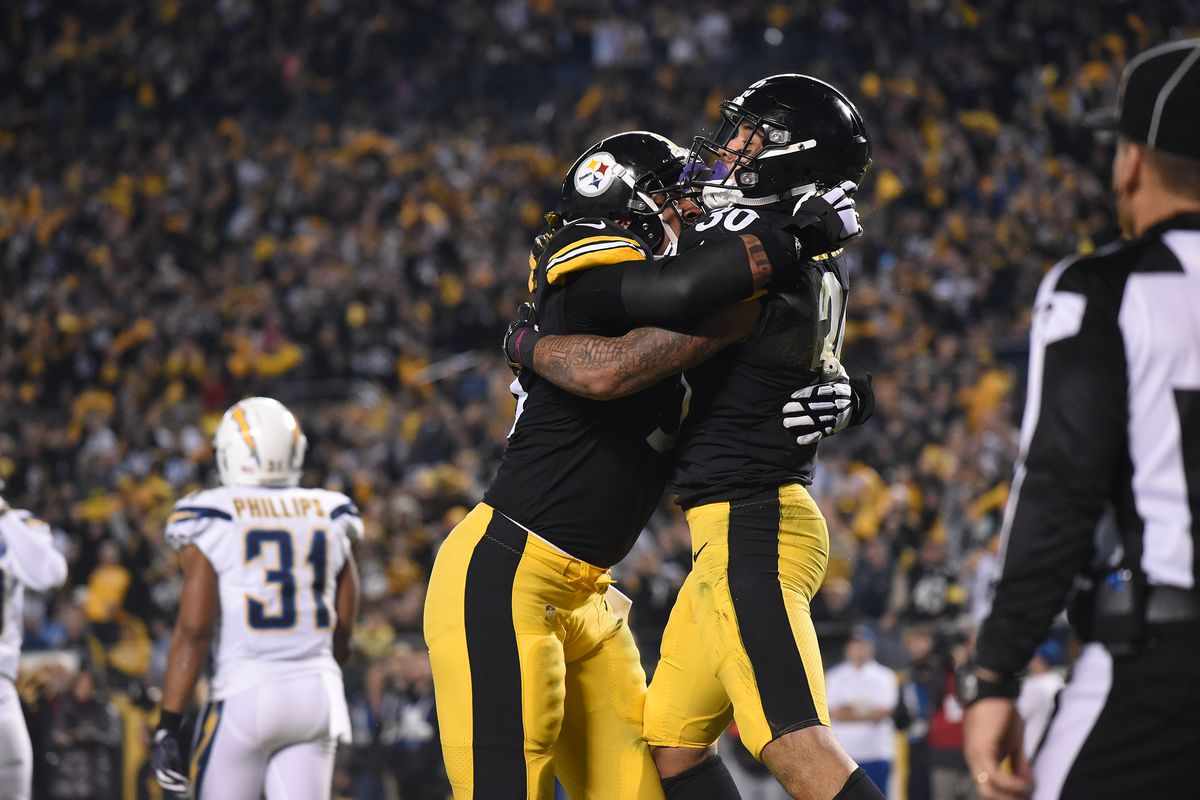 Pittsburgh Steelers running back James Conner celebrates a first quarter touchdown with center Maurkice Pouncey against the Los Angeles Chargers at Heinz Field.