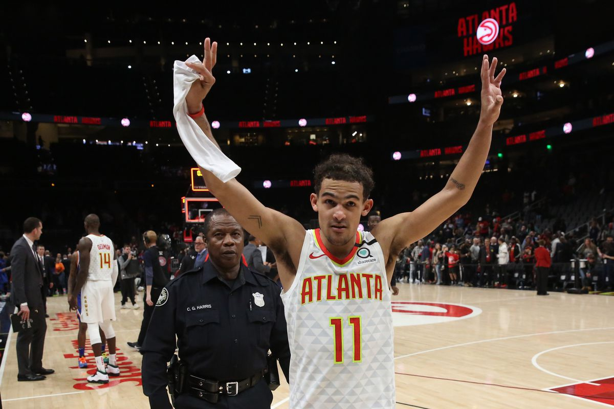 Atlanta Hawks guard Trae Young acknowledges the crowd after an overtime loss to the New York Knicks at State Farm Arena.