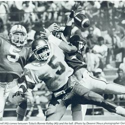 Kyle Morrell, left, helps break up a pass intended for Tulsa's Ronnie Kelley during BYU's unbeaten season.