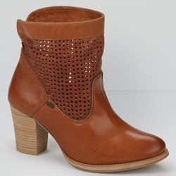 """Perforated leather boots, <a href=""""http://us.levi.com/product/index.jsp?productId=17100416&Camp=CME%3AWomensShoesFS%3A20130221&csm=409004731&csc=586163&csa=409005411&csu=586170&"""">$158</a>"""