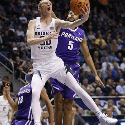 Brigham Young Cougars guard TJ Haws (30) drives on Portland Pilots guard D'Marques Tyson (5) in Provo on Thursday, Dec. 28, 2017. BYU won 69-45.