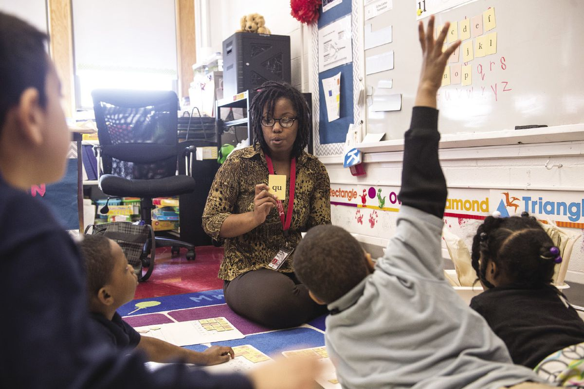 A teacher is shown with her students during class in Philadelphia.