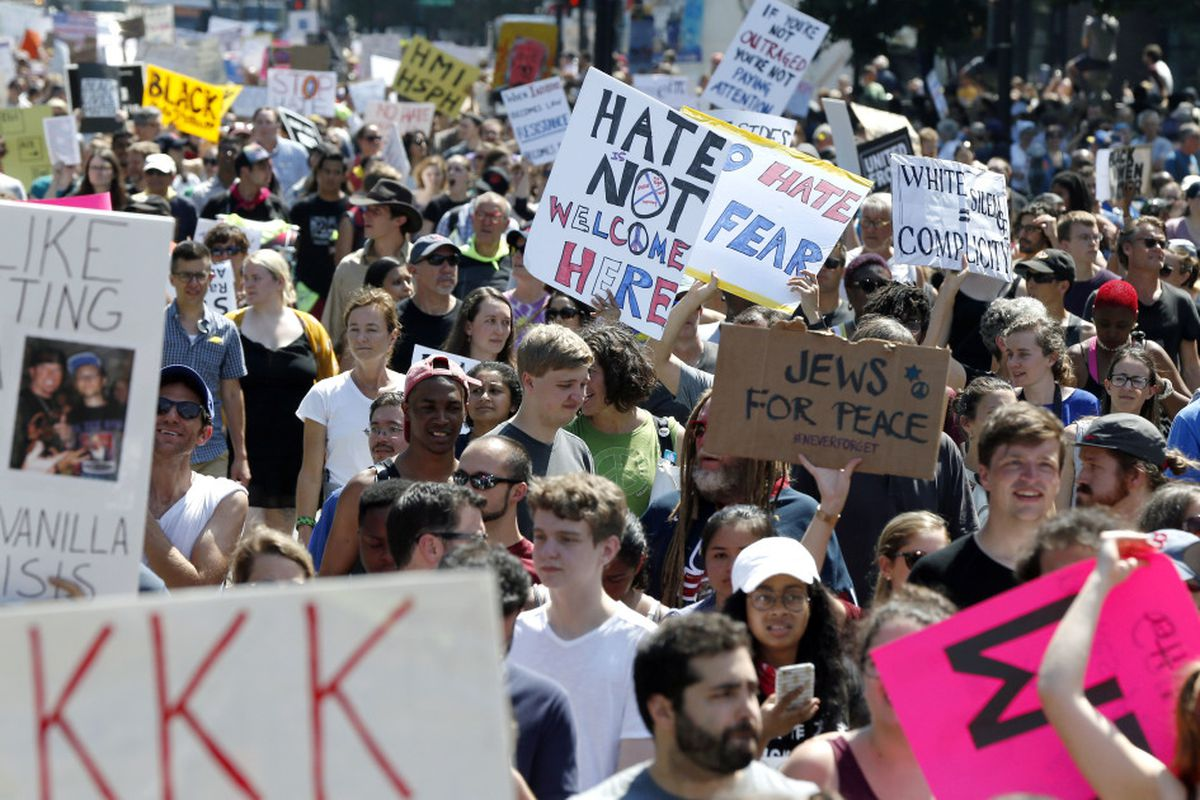 Free speech rally' cut short after massive counterprotest in