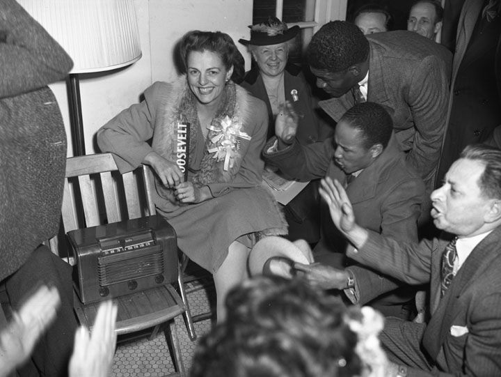 Future congresswoman Helen Gahagan Douglas (center) sits with other supporters of incumbent President Franklin Delano Roosevelt awaiting the results of the 1940 election.