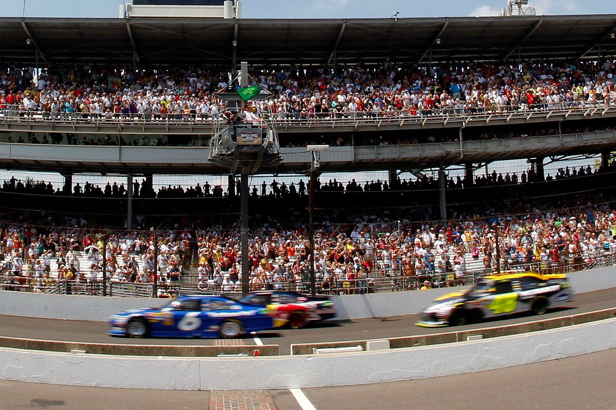David Ragan, driver of the #6 UPS/Ned Jarrett NASCAR Hall of Fame Ford, and Kasey Kahne, driver of the #4 Red Bull Toyota, lead the field to the green flag to start the NASCAR Sprint Cup Series Brickyard 400 at Indianapolis Motor Speedway on July 31, 2011 in Indianapolis, Indiana.