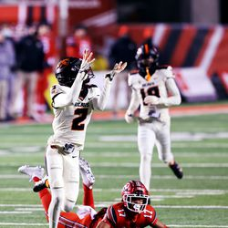Oregon State Beavers defensive back Nahshon Wright (2) reaches for and bobbles an interception after Utah Utes wide receiver Devaughn Vele (17) fell down on the play as Utah and Oregon State play a college football game at Rice Eccles stadium in Salt Lake City on Saturday, Dec. 5, 2020. Utah won 30-24.