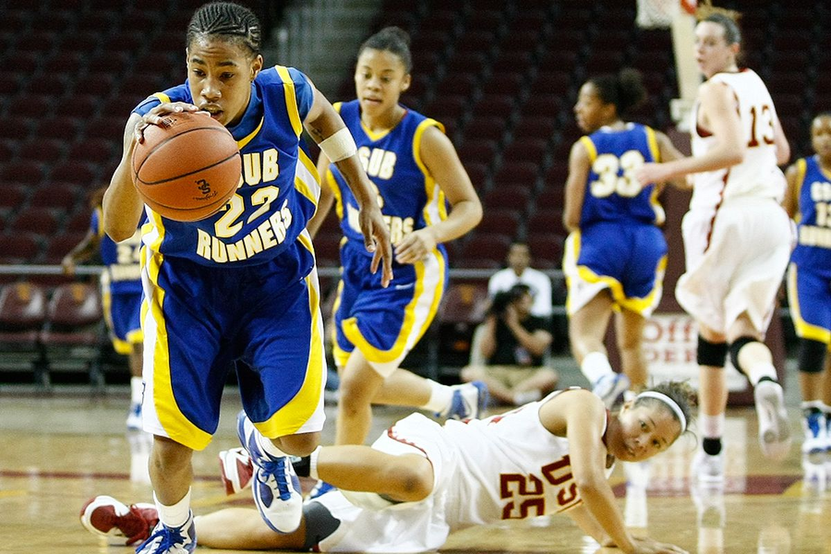 """Cal State Bakersfield senior guard Katie Williams gets a steal against USC in the Women of Troy Basketball Classic in December. <em>Photo by <a href=""""http://www.photoshelter.com/c/112575"""" target=""""new"""">Craig Bennett/112575 Media</a>.</em>"""