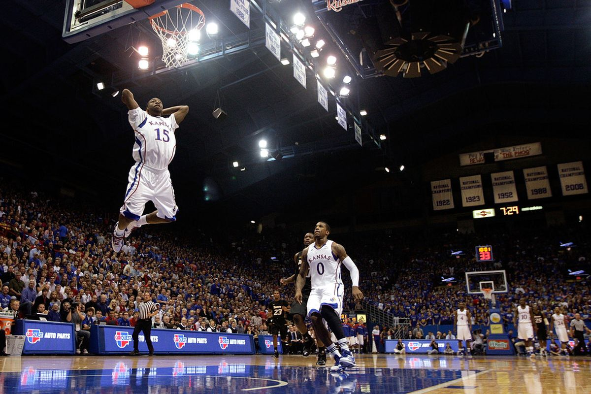 LAWRENCE, KS - NOVEMBER 11:  Elijah Johnson #15 of the Kansas Jayhawks goes up for a dunk during the game against the Towson Tigers on November 11, 2011 at Allen Fieldhouse in Lawrence, Kansas.  (Photo by Jamie Squire/Getty Images)