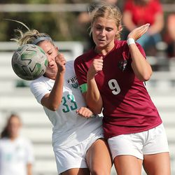Farmington's Sydney Randall and Viewmont's Kennahdy Johnson collide as they go after the ball as Farmington and Viewmont girls battle to a 1-1 tie at the end of regulation play in Bountiful on Tuesday, Sept. 22, 2020.. Farmington went on to advance with a 3-1 win in penalty kicks.