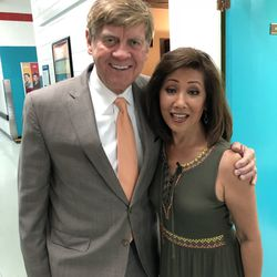 Linda Yu with Steve Sanders outside the WGN Morning News studio.   Brian Rich for the Sun-Times