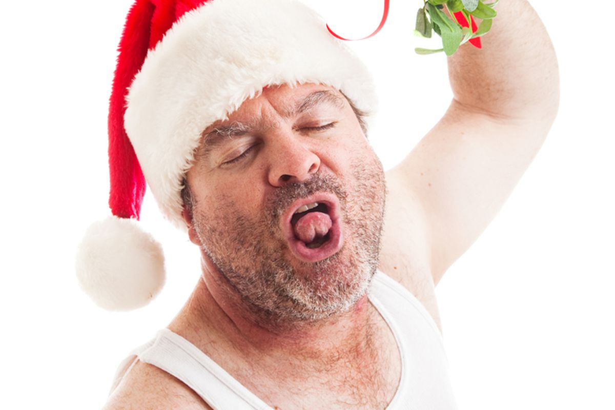 """Hopefully, this guy won't be there. Image credit: <a href=""""http://www.shutterstock.com/pic-159804446/stock-photo-unshaven-middle-aged-man-in-his-undershirt-wearing-a-santa-hat-and-holding-mistletoe-waiting-for.html?"""">Shutterstock/Lisa F. Young</a>"""