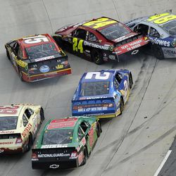 Clint Bowyer (15), Jeff Gordon (24) and Jimmie Johnson (48) get sideways during the closing laps of the NASCAR Sprint Cup Series auto race at Martinsville Speedway in Martinsville, Va., Sunday, April 1, 2012.