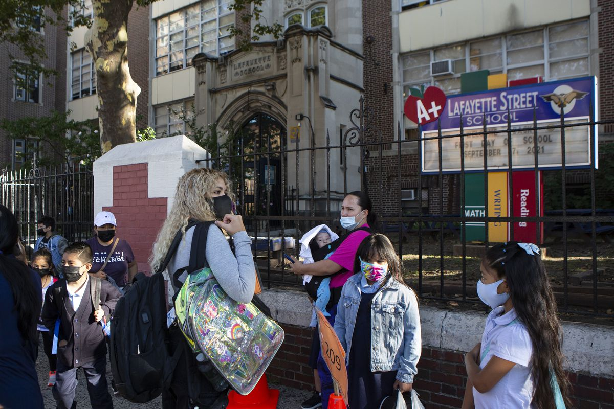 Several students and parents make their way into Newark's Lafayette Street School on the first day of classes.