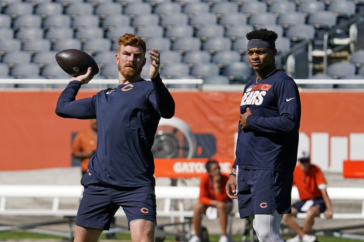 Bears quarterbacks Andy Dalton and Justin Fields warm up before Saturday's preseason game against the Dolphins.