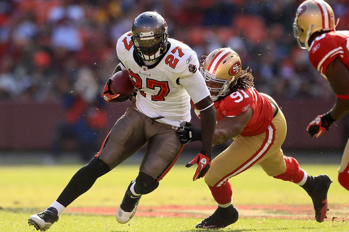 SAN FRANCISCO - NOVEMBER 21:  LeGarrette Blount #27 of the Tampa Bay Buccaneers is tackled by the Ray McDonald #91 of the San Francisco 49ers at Candlestick Park on November 21 2010 in San Francisco California.  (Photo by Ezra Shaw/Getty Images)