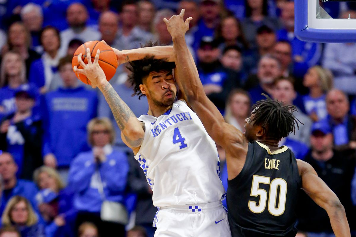 Kentucky Wildcats forward Nick Richards rebounds the ball against Vanderbilt Commodores forward Ejike Obinna in the second half at Rupp Arena