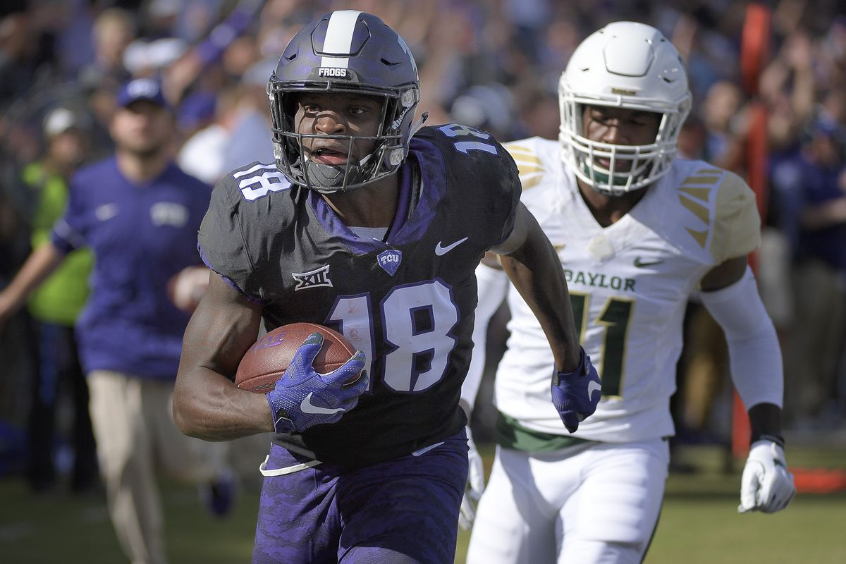 Texas Christian wide receiver Jalen Reagor scores on a 30-yard third-quarter touchdown catch in front of Baylor cornerback Jameson Houston (11) at Amon G. Carter Stadium in Fort Worth, Texas, on Friday, Nov. 24, 2017. TCU won, 45-22.