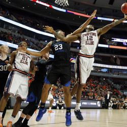 Illinois forward Leron Black (12) rebounds the ball against BYU forward Yoeli Childs (23) during the first half of an NCAA college basketball game Saturday, Dec. 17, 2016, in Chicago. (AP Photo/Nam Y. Huh)