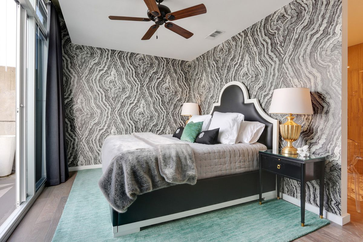 A master bedroom with oyster-like wallpaper in the master bedroom.