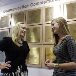 Twin sisters Lindsay and Lexie Kite talk with each other at the University of Utah in Salt Lake City  Thursday, Sept. 8, 2011.