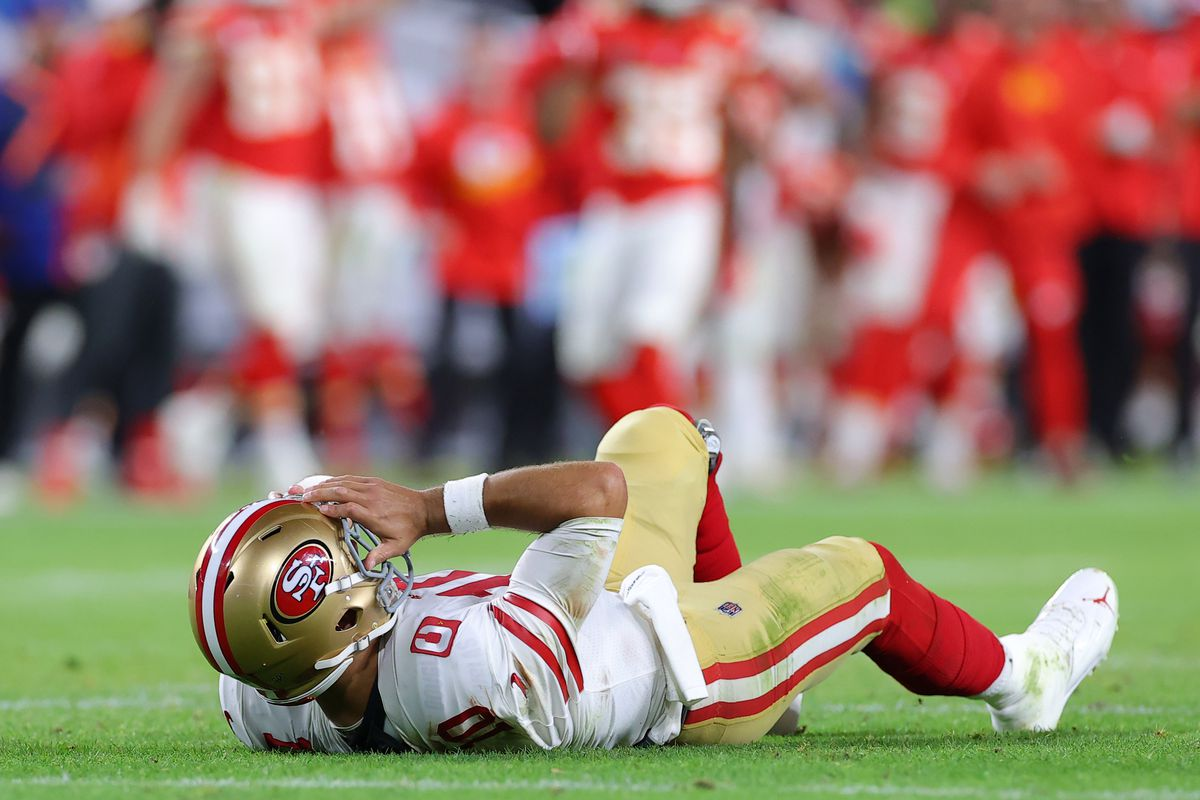 49ers quarterback Jimmy Garoppolo lies on the ground after being hit in Sunday night's Super Bowl.