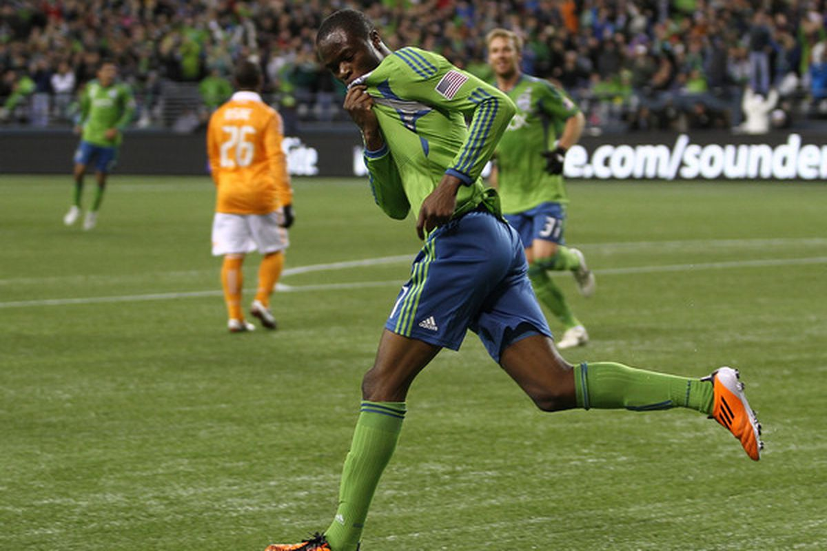 SEATTLE - MARCH 25:  Steve Zakuani #11 of the Seattle Sounders FC reacts after scoring a goal against the Houston Dynamo at Qwest Field on March 25, 2011 in Seattle, Washington. (Photo by Otto Greule Jr/Getty Images)