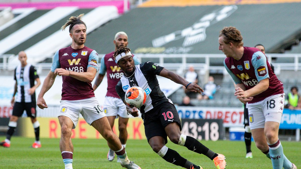Newcastle United's Allan Saint-Maximin battles with Aston Villa's Jack Grealish and Matt Targett during the Premier League match between Newcastle United and Aston Villa at St. James Park on June 24.