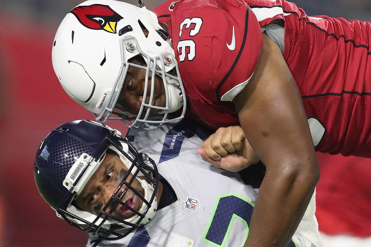 Former Arizona Cardinals DE Calais Campbell hits Seattle Seahawks QB Russell Wilson on October 23, 2016