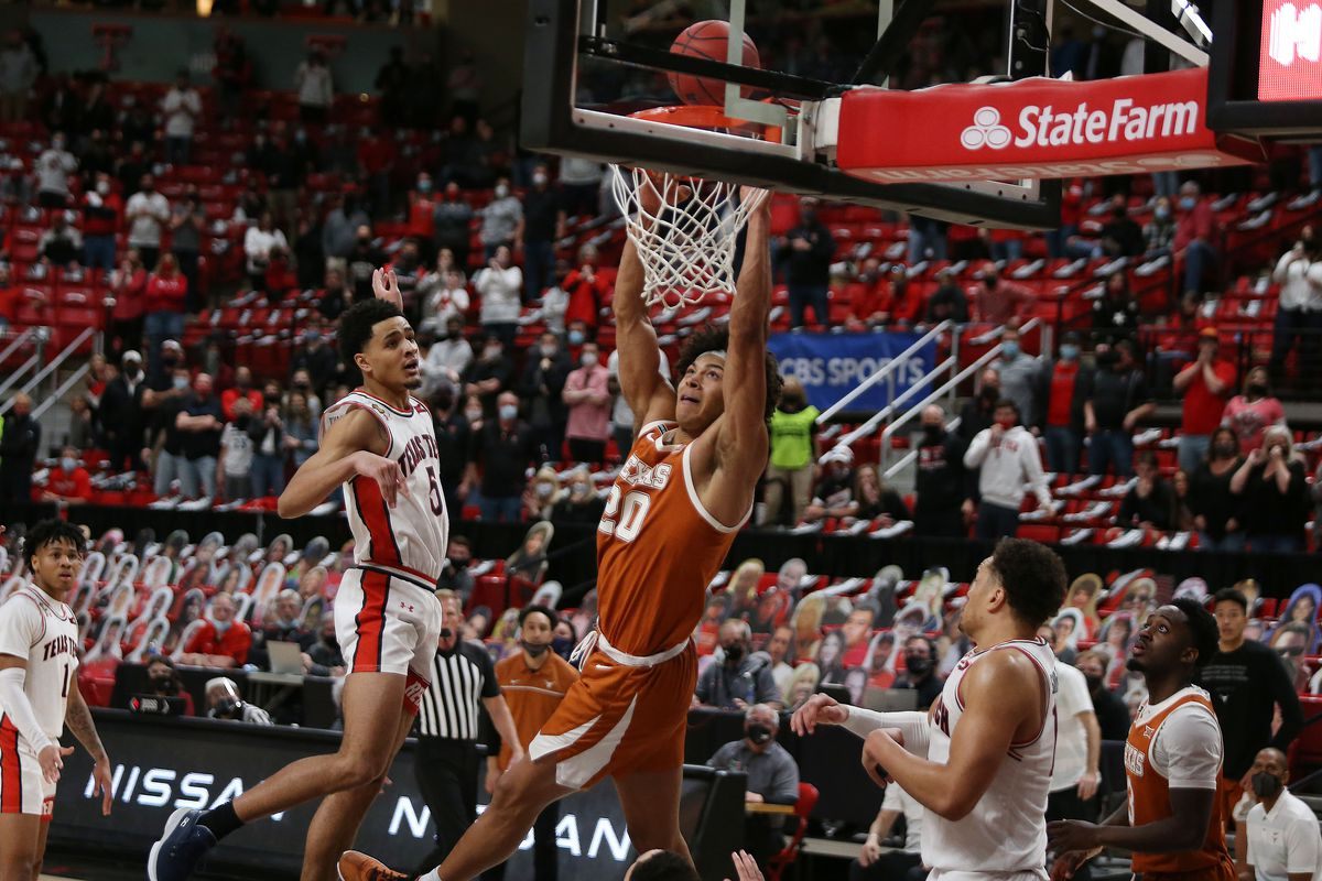 Texas Longhorns forward Jericho Sims slam dunks the ball against the Texas Tech Red Raiders in the second half at United Supermarkets Arena.
