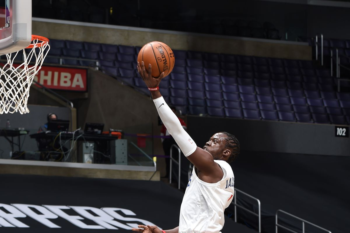 Reggie Jackson #1 of the LA Clippers drives to the basket against the Utah Jazz during a preseason game on December 17, 2020 at STAPLES Center in Los Angeles, California.