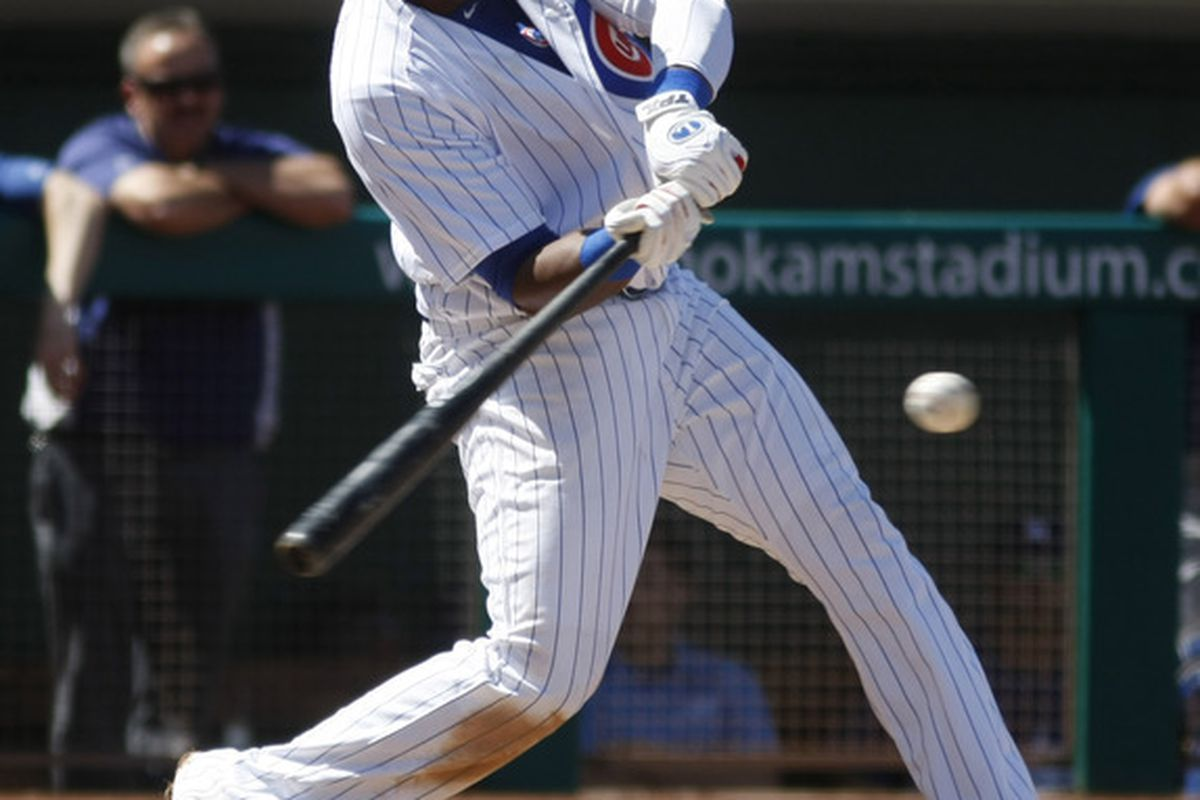 Mesa, AZ, USA; Chicago Cubs shortstop Starlin Castro hits against the Los Angeles Dodgers in the first inning at HoHoKam Stadium. Credit: Rick Scuteri-US PRESSWIRE