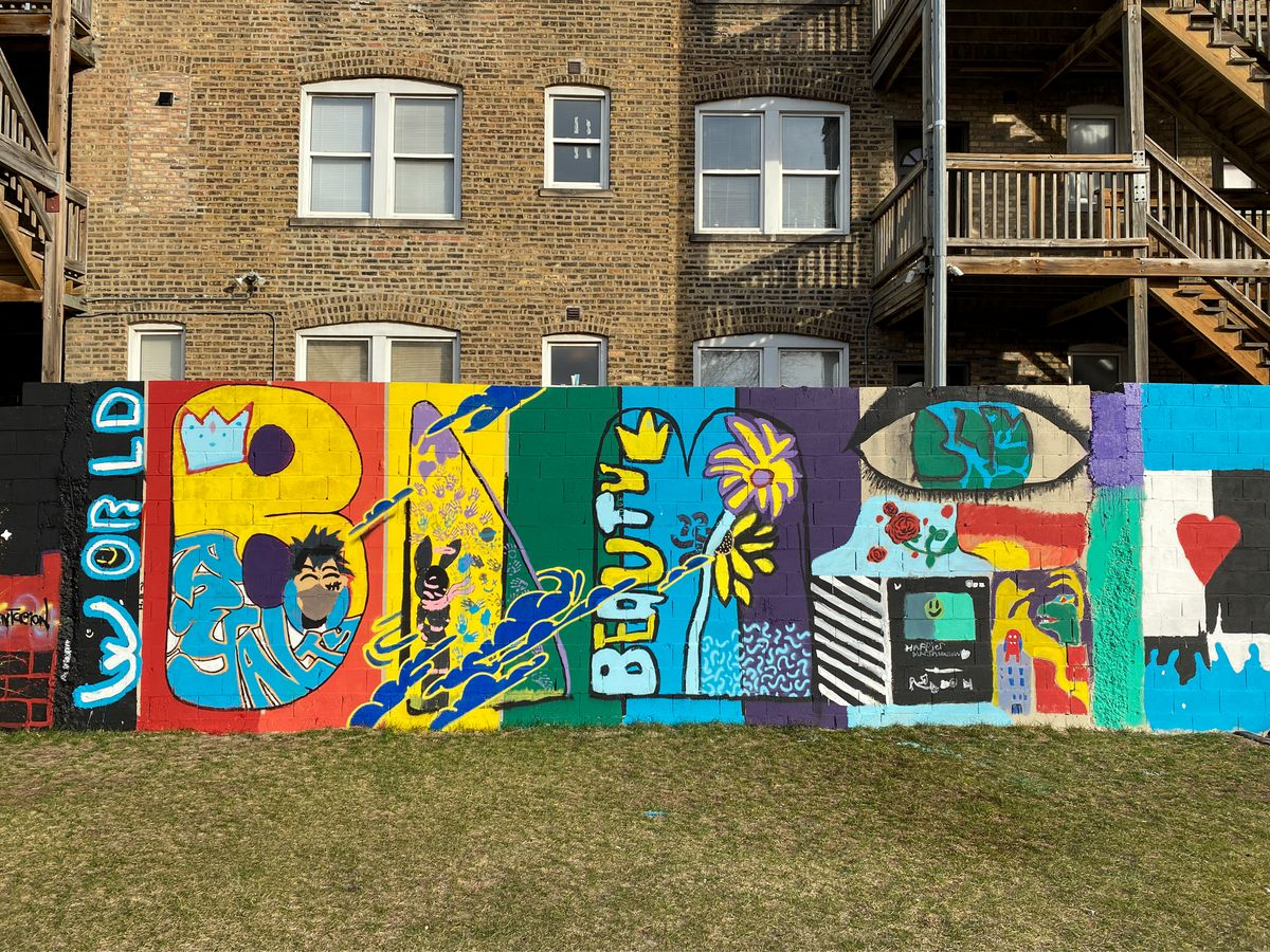 """The letters """"BLM"""" — for Black Lives Matter — are at the center of a mural near Division Street and Springfield Avenue."""