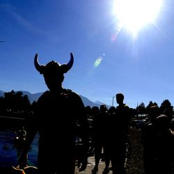 Last year's champion Ross Bowman wears a viking hat before making his way to his pumpkin to compete in the 2013 Mountain Valley Seed Co. Ginormous Pumpkin Regatta at Sugarhouse Park on Saturday, October 19, 2013.