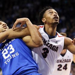 Brigham Young Cougars forward Yoeli Childs (23) and Gonzaga Bulldogs forward Johnathan Williams (3) battle for position as BYU and Gonzaga play in an NCAA basketball game in the Marriott Center in Provo on Saturday, Feb. 24, 2018.