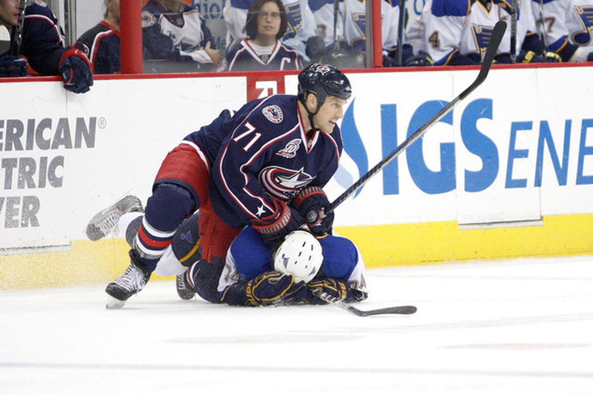 COLUMBUS OH - NOVEMBER 10:  Chris Clark #11 of the Columbus Blue Jackets holds down T.J. Oshie #74 of the St. Louis Blues during the second period on November 10 2010 at Nationwide Arena in Columbus Ohio.  (Photo by John Grieshop/Getty Images)