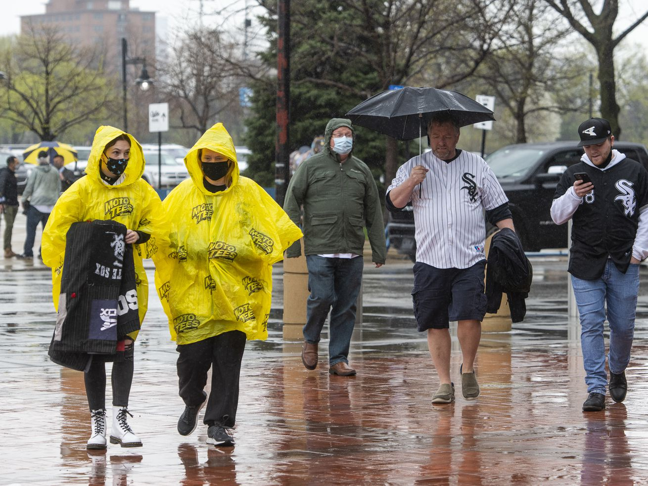 Chicago White Sox fans walk outside the park before the rain-delayed home opener on Thursday, April 8, 2021.
