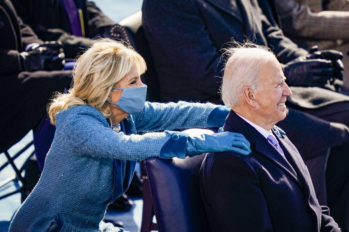 First lady Jill Biden puts her hands on President Joe Biden's shoulders after he delivered his inaugural address