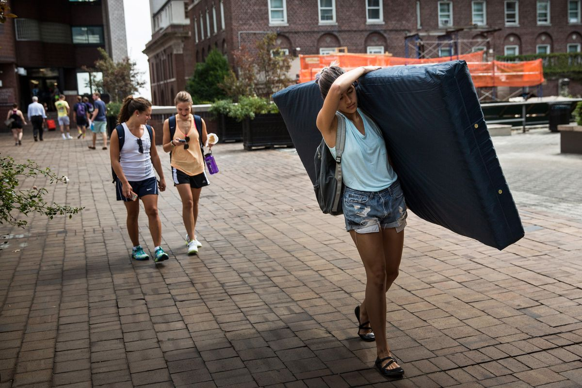 Columbia student Emma Sulkowicz carries her mattress to protest the university's handling of her sexual assault case