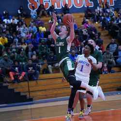 Lane's Michael Molloy (1) gets down court for a basket against Proviso East, Wednesday 02-27-19. Worsom Robinson/For Sun-Times