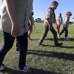 Patrol leader Makaylee Carlisle practices the rest step, a hiking technique to conserve energy, during a Boy Scout meeting for the all-female Troop 314 at Parkview Park in Stansbury Park on Monday, July 6, 2020.