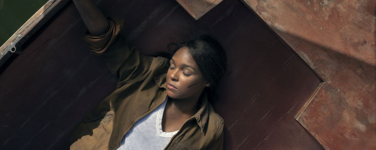 Janelle Monáe lies unconscious in the bottom of a rowboat in the water in season 2 of Amazon's Homecoming.