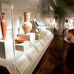 Museum visitors view a display of Egyptian pottery from the New Kingdom period, Dynasty 18, 1570-1293 B.C. The exhibit runs until June 2005.