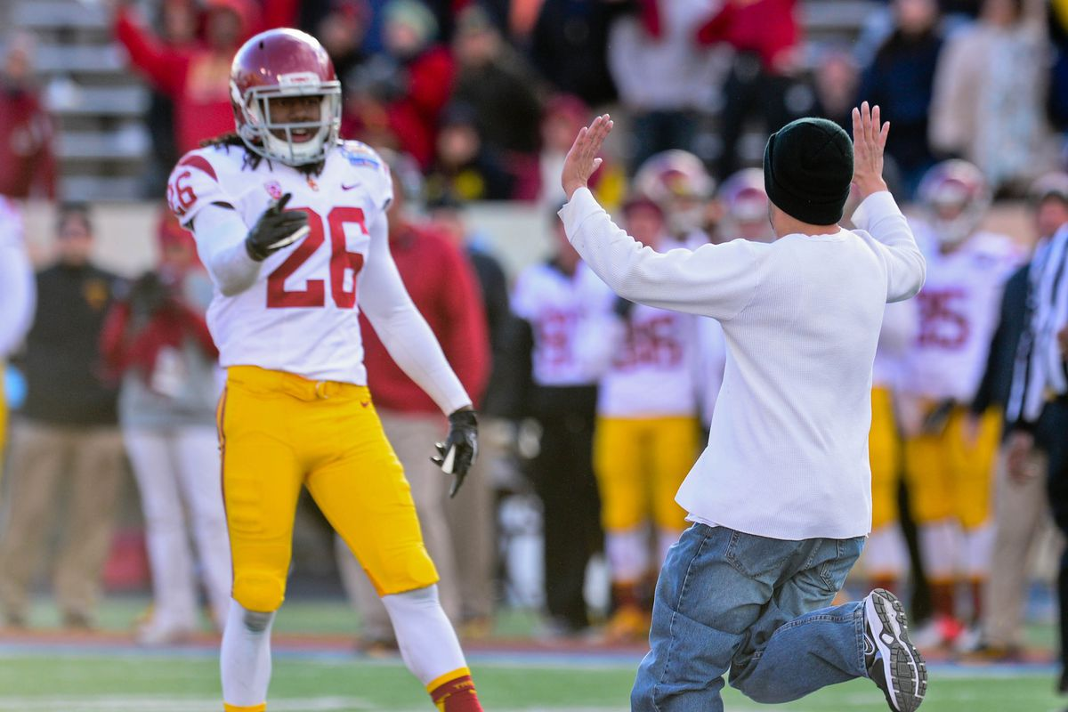 Shaw won't be getting any high-fives from Trojan fans.