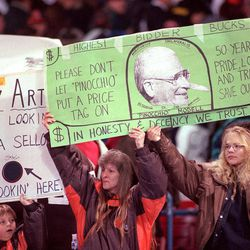 FILE - This Nov. 26, 1995 file photo shows fans holding signs during a game against the Pittsburgh Steelers at Cleveland Stadium in Cleveland. 1995 file photo. Former Baltimore Ravens owner Art Modell has died. He was 87. The team said Modell died of natural causes early Thursday, Sept. 6, 2012, at Johns Hopkins Hospital, where he had been admitted Wednesday. Modell was among the most important figures in the NFL as owner of the Cleveland Browns, who became the Ravens after he took the team to Baltimore in 1996 _ a move that hounded him the rest of his life.