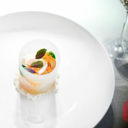 """Kampachi, with brook trout roe, pomelo, ginger ice """"sleeve,"""" and Thai basil."""