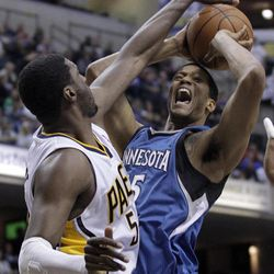Indiana Pacers center Roy Hibbert, left, blocks the shot of Minnesota Timberwolves forward Anthony Randolph in the first half of an NBA basketball game in Indianapolis, Monday, April 16, 2012. A jump ball was called on the play.