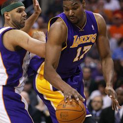 Los Angeles Lakers' Andrew Bynum (17) spins around Phoneix Suns' Jared Dudley during the first half of an NBA basketball game, Saturday, April 7, 2012, in Phoenix.
