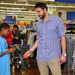 Magic forward Josh McRoberts helps a member from the Boys & Girls Clubs during the Magic and Pepsi holiday shopping spree event on December 18.